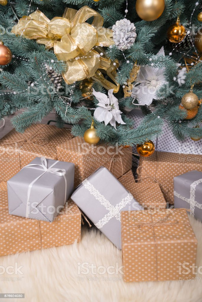 Many boxes with Christmas gifts under the Christmas tree stock photo