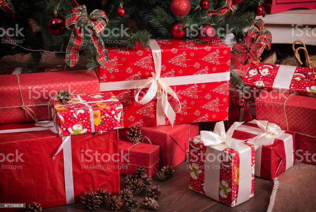 Many boxes with Christmas presents under the Christmas tree stock photo