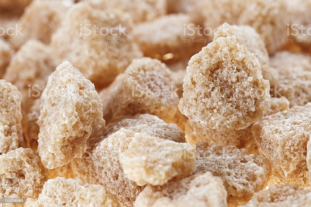 Many brown lump cane sugar cubes , food background royalty-free stock photo