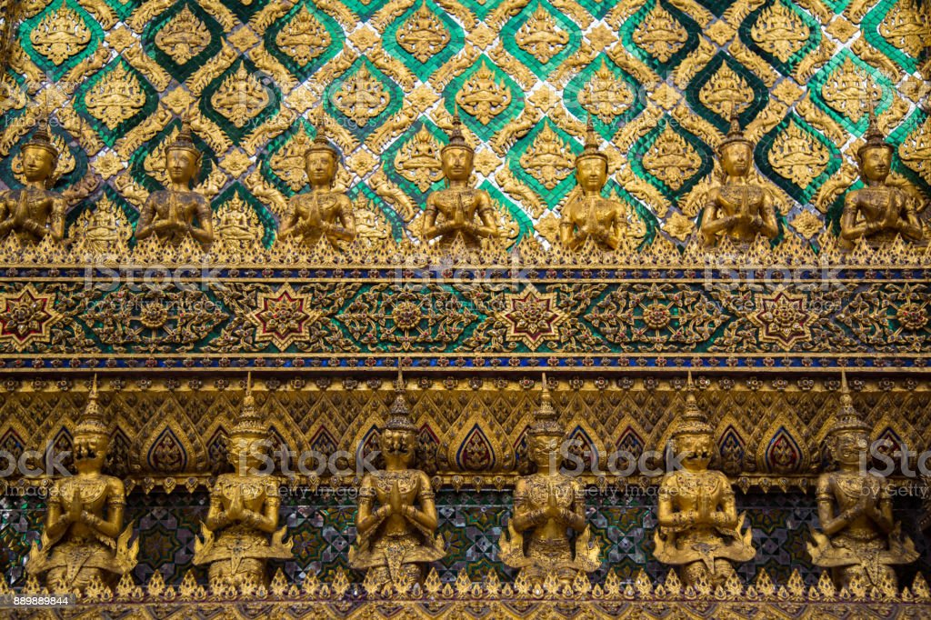 Many Buddha statues and details of a palace stock photo