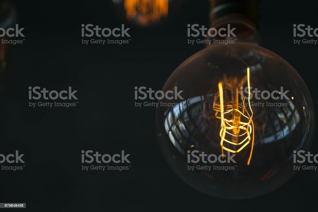 Many bulbs with brick background royalty-free stock photo