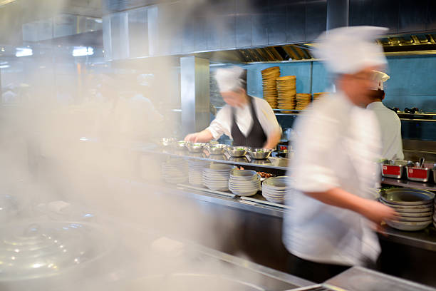 many busy chefs working in kitchen - xxxlarge - busy restaurant kitchen stock pictures, royalty-free photos & images