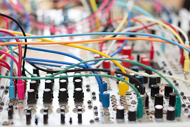 many cables connected on analog synthesizer - modular many cables connected on analog synthesizer - modular synth synthesizer stock pictures, royalty-free photos & images