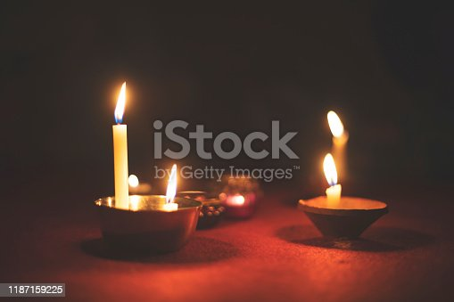 Many candlelights on the floor in dim light