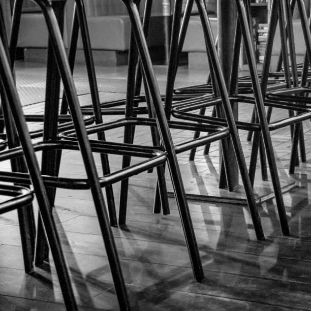 Many chair legs crossed over stock photo