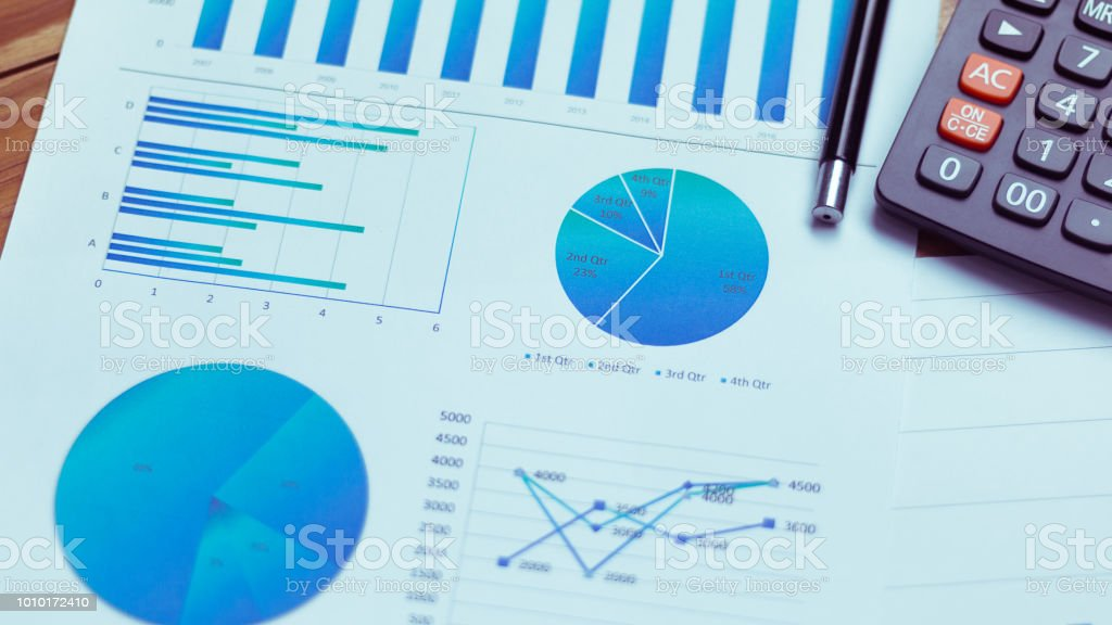 Many charts and graphs reflect the company's concept of data collection and statistical performance in the past year. stock photo