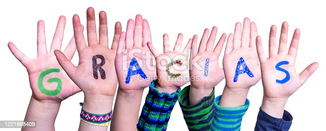 516544386 istock photo Many Children Hands Building Word Gracias Means Thank You, Isolated Background 1221868409