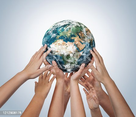 Many children hands holding planet earth isolated on blue background with copy space. Element of this image furnished by NASA ( https://earthobservatory.nasa.gov/blogs/elegantfigures/2011/10/06/crafting-the-blue-marble/ )