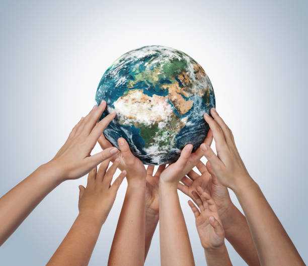 Many children hands holding planet earth. Element of this image furnished by NASA ( https://earthobservatory.nasa.gov/blogs/elegantfigures/2011/10/06/crafting-the-blue-marble/ ) stock photo