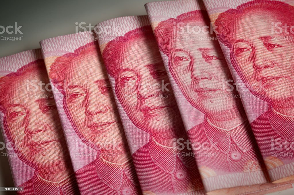 Many Chinese 100 Chinese Yuan paper Currency stock photo