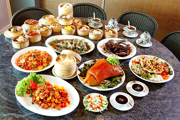 many chinese food on table - chinese food stock photos and pictures