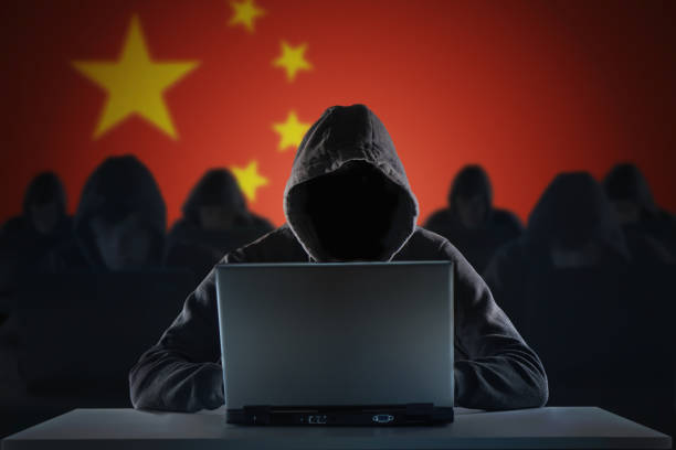 Many chinese hackers in troll farm. Privacy and security concept. stock photo