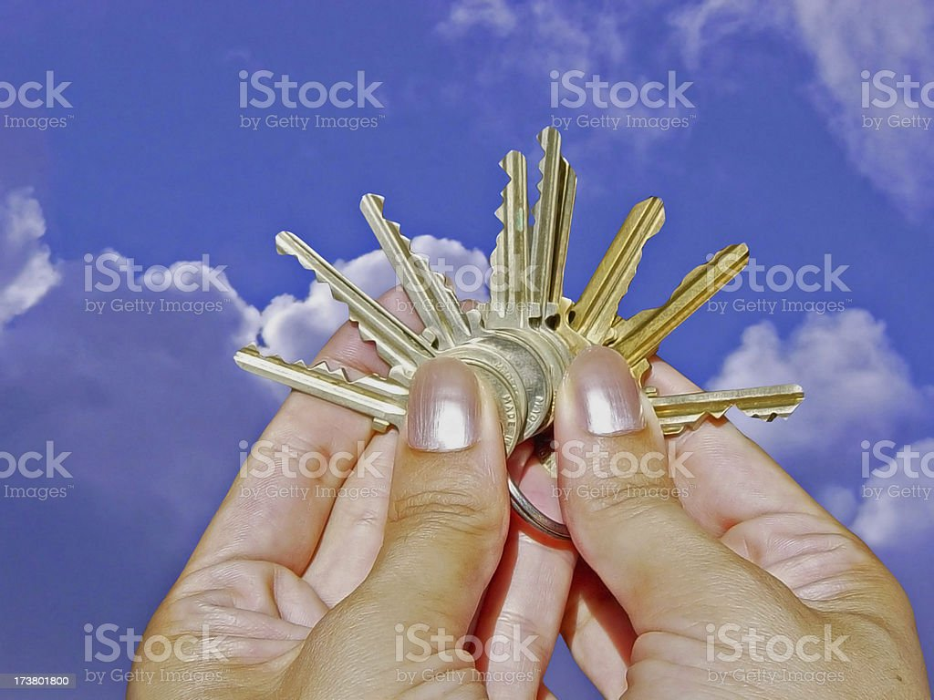Many Choices: Hand Holding Assortment of Keys royalty-free stock photo