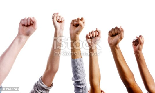 Multiracial clenched fists raised in the air could signify approval or defiance. Isolated against a white background.