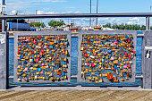 HELSINKI, FINLAND - JULY 16, 2016: Many closed lock on the Bridge of love in Helsinki