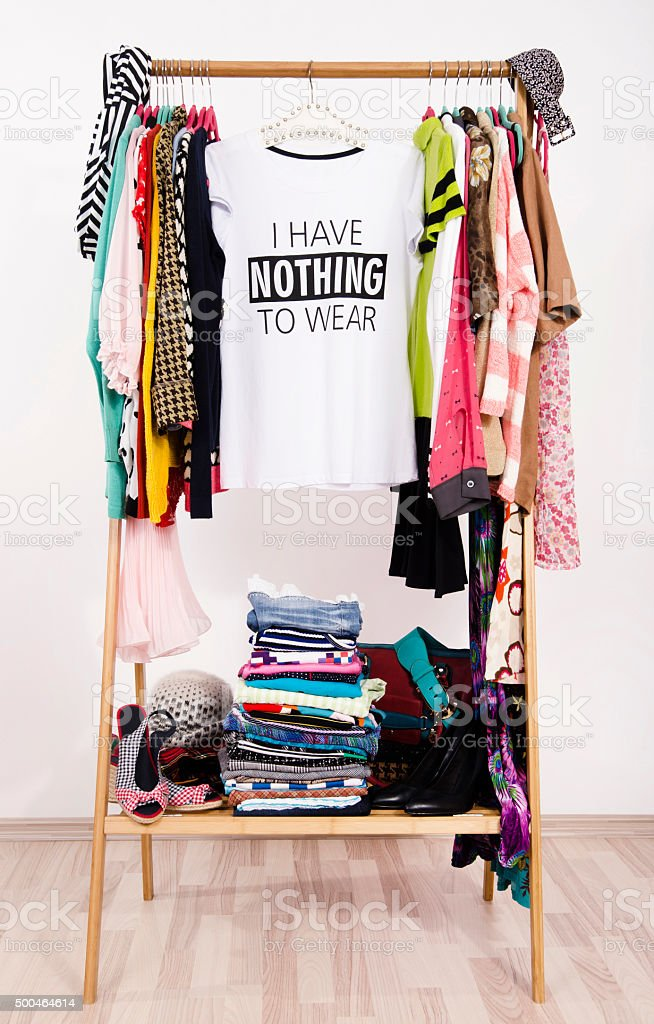 Many clothes and a nothing to wear top. stock photo
