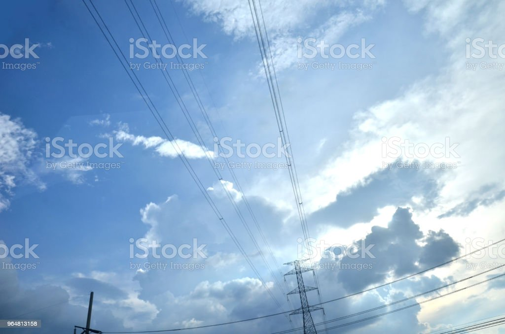 Many clouds in the bright blue sky. royalty-free stock photo