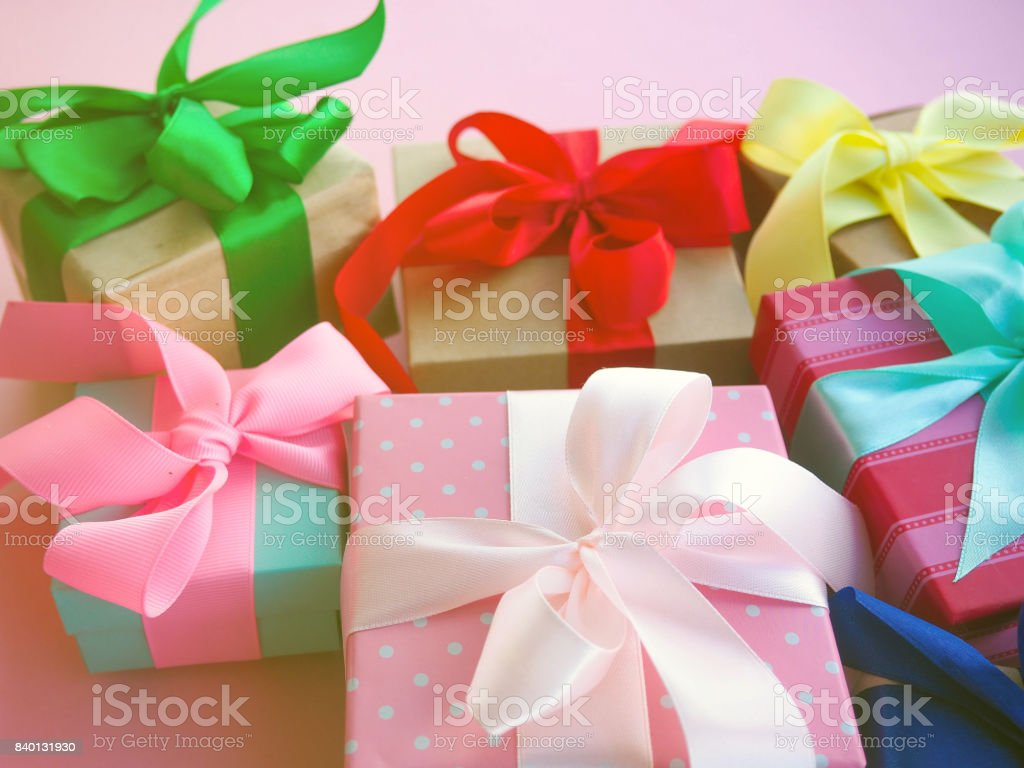 many color gift boxes with colorful ribbons, as a symbol of the...