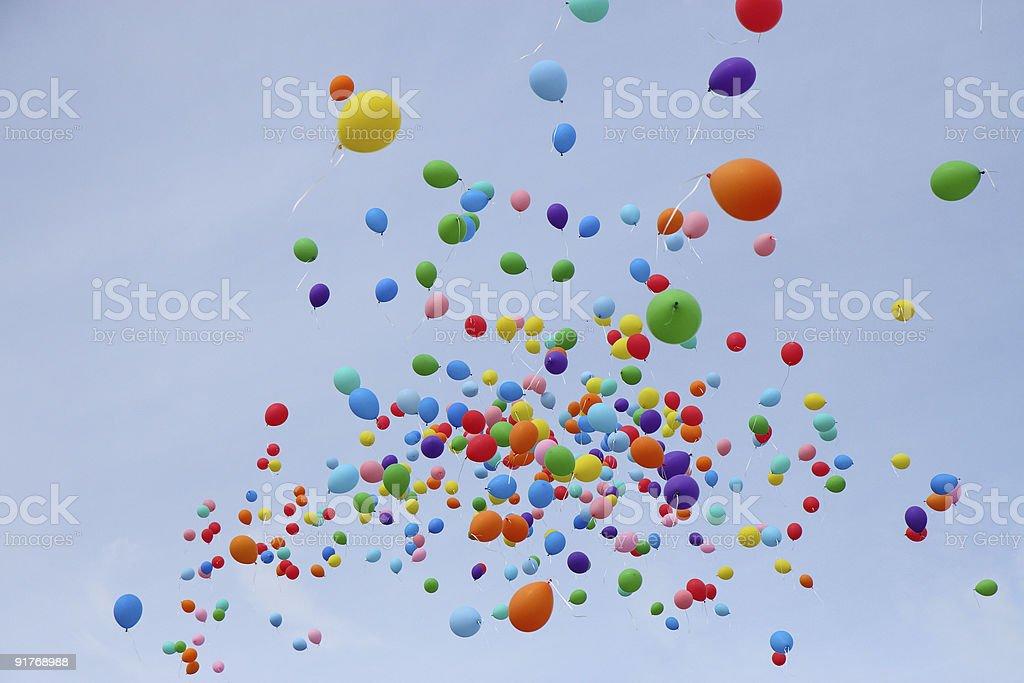 Many colored balloons fly into sky royalty-free stock photo