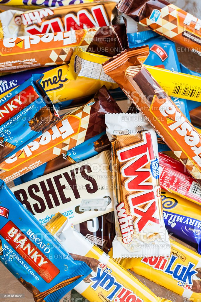 many colored chocolate different brands stock photo