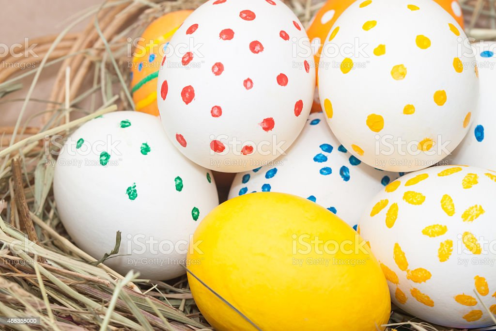 many colored easter eggs in basket royalty-free stock photo