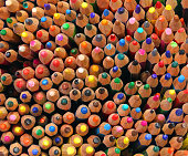 many colored pencils in a container for sale in a stationery