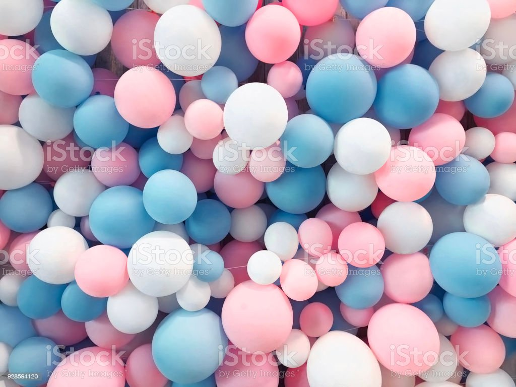 Many colorful balloons decorated wall as background stock photo