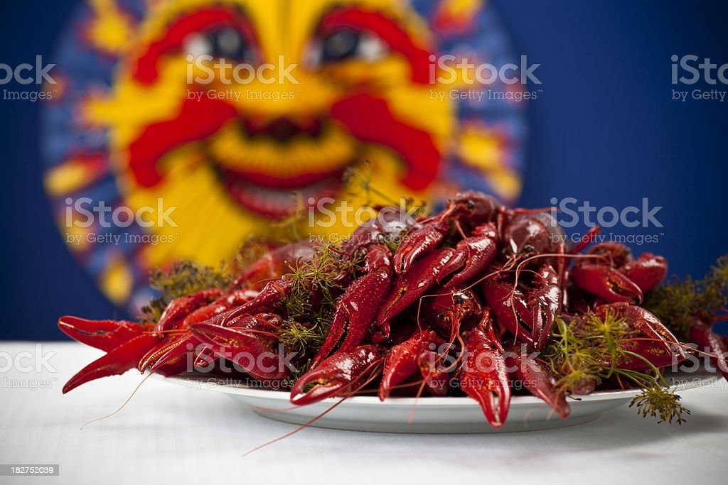 Many colorful crayfish on a plate with dill, blue background stock photo