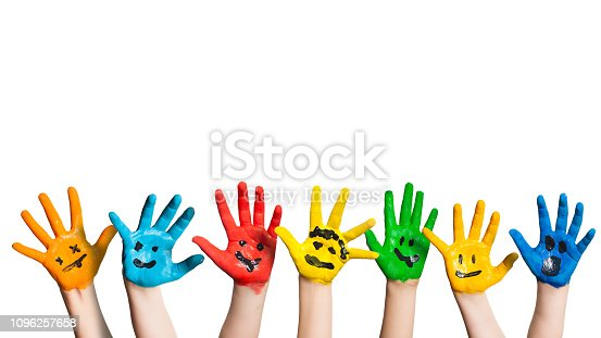 many colorful hands with smileys in front of white background