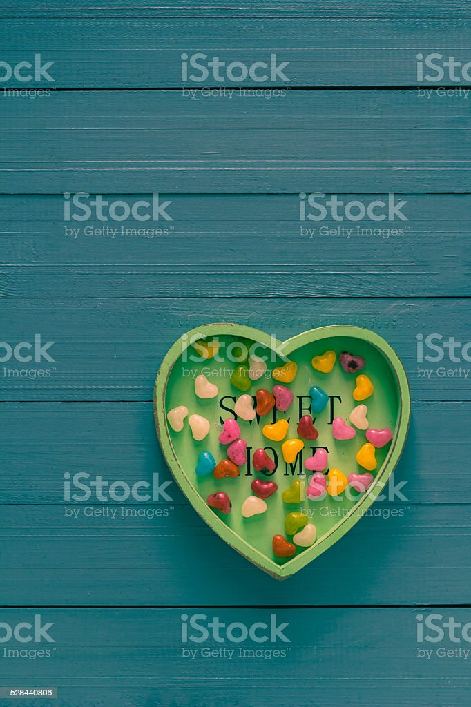 Many colorful little hearts wooden background stock photo