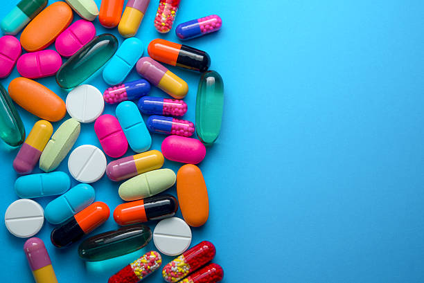 Many colorful pills stock photo