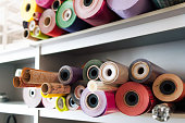 a lot of colorful rolls of wrapping paper. Showcase of shop