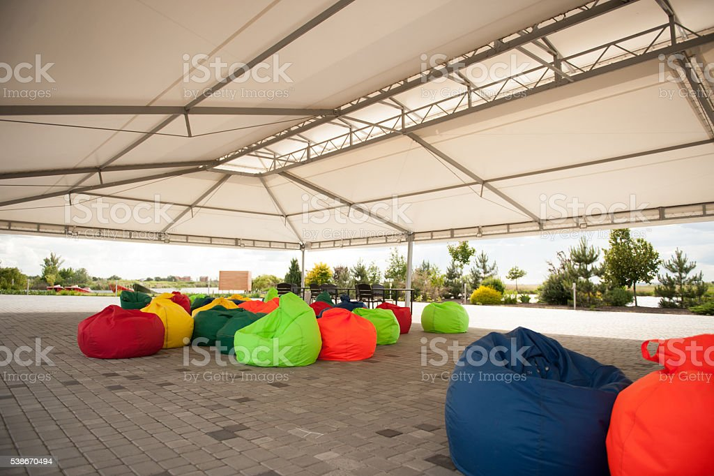 many colorful soft beanbag seats stock photo