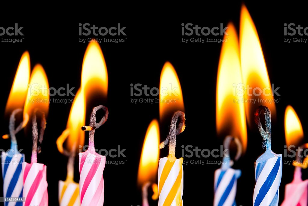 many coloured candles stock photo