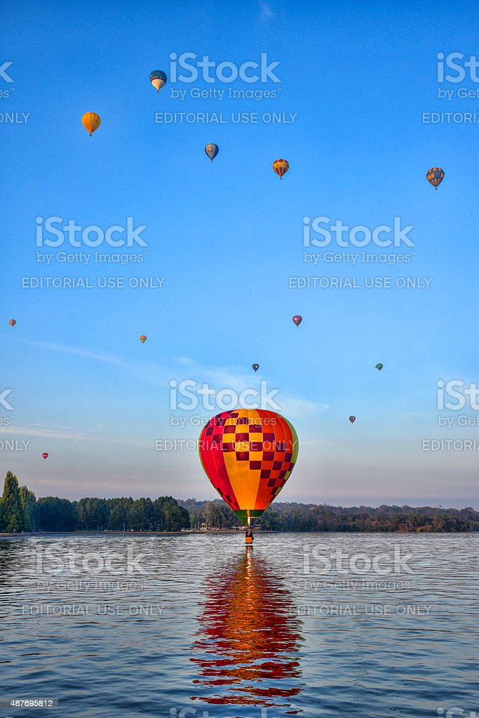 Many colourful hot air balloons over lake Burley Griffin stock photo