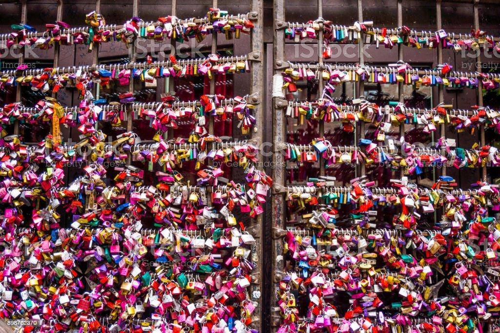 Many colourful love padlocks at the wall of Juliet's house, Verona,  Italy stock photo
