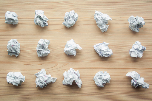 istock Many crumpled white paper balls from above background. Texture of crumpled paper balls.  Crumpled paper as brainstorming, creativity concept, mistakes and creation symbol. 1146260677