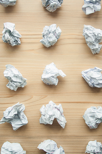 istock Many crumpled white paper balls from above background. Texture of crumpled paper balls.  Crumpled paper as brainstorming, creativity concept, mistakes and creation symbol. 1146260693