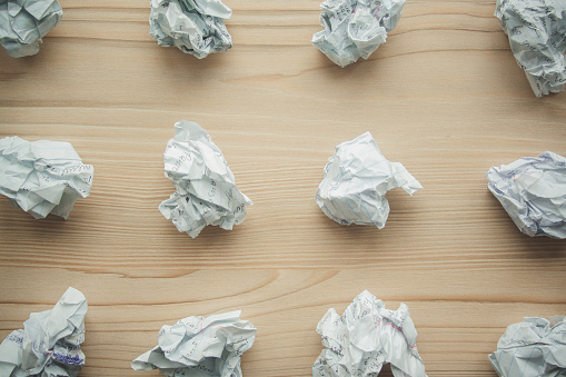 istock Many crumpled white paper balls from above background. Texture of crumpled paper balls.  Crumpled paper as brainstorming, creativity concept, mistakes and creation symbol. 1146260699