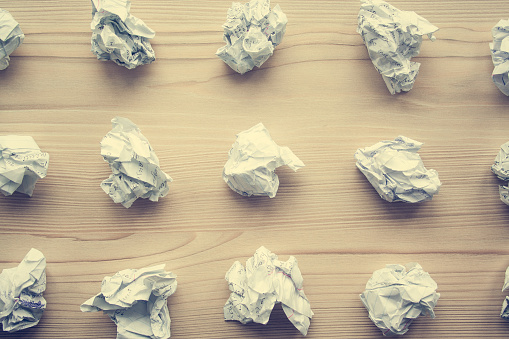 istock Many crumpled white paper balls from above background. Texture of crumpled paper balls.  Crumpled paper as brainstorming, creativity concept, mistakes and creation symbol. toned 1146260710