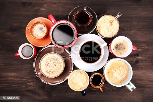 istock Many cups of coffee on wooden table 504333530