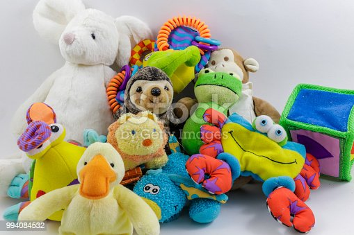 Many Cute Stuffed Animals in a Pile