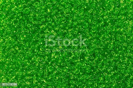 istock Many dark green seed beads background 827419288