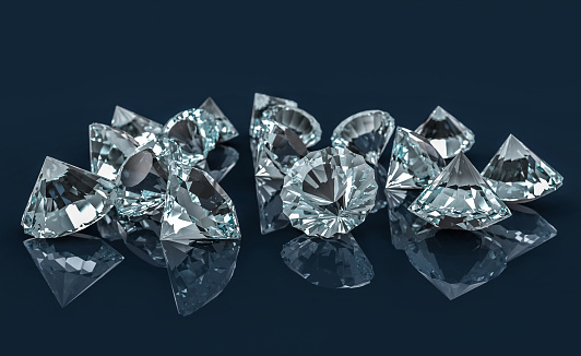istock Many diamonds on reflective desk 917027868