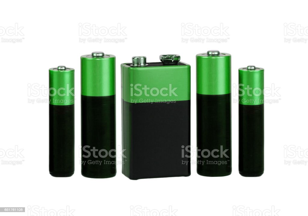 Many different batteries, type AAA, type AA, type PP3, white background, isolated stock photo