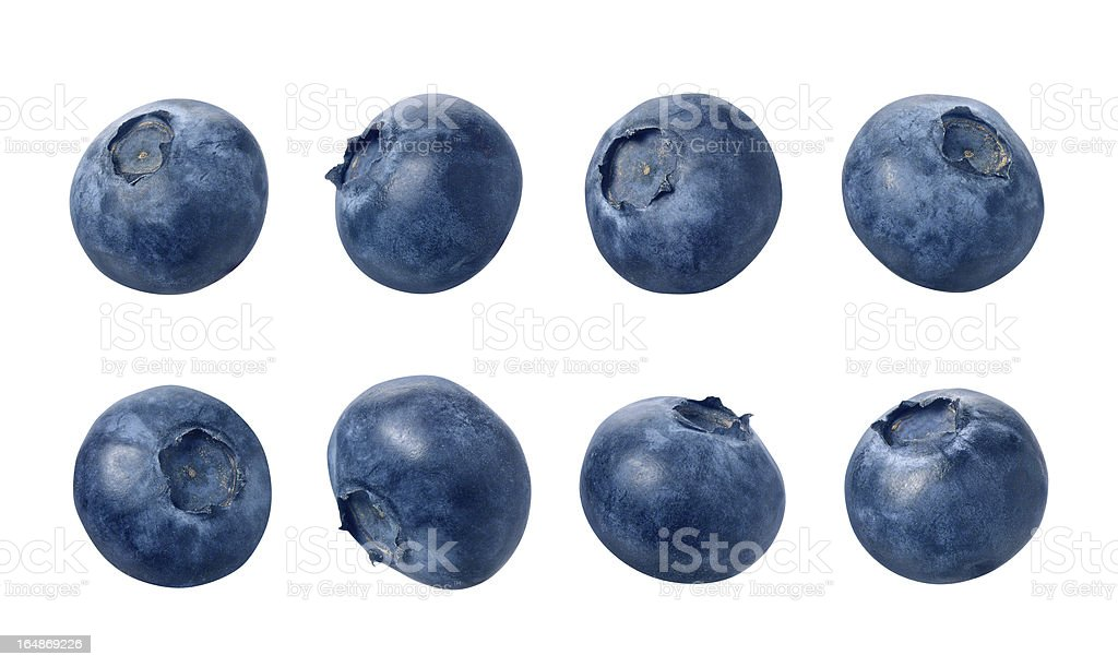 Many different blueberries sitting in a row of 4 stock photo
