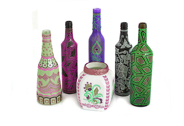many different bottles, painted dot painted on isolated background. stock photo
