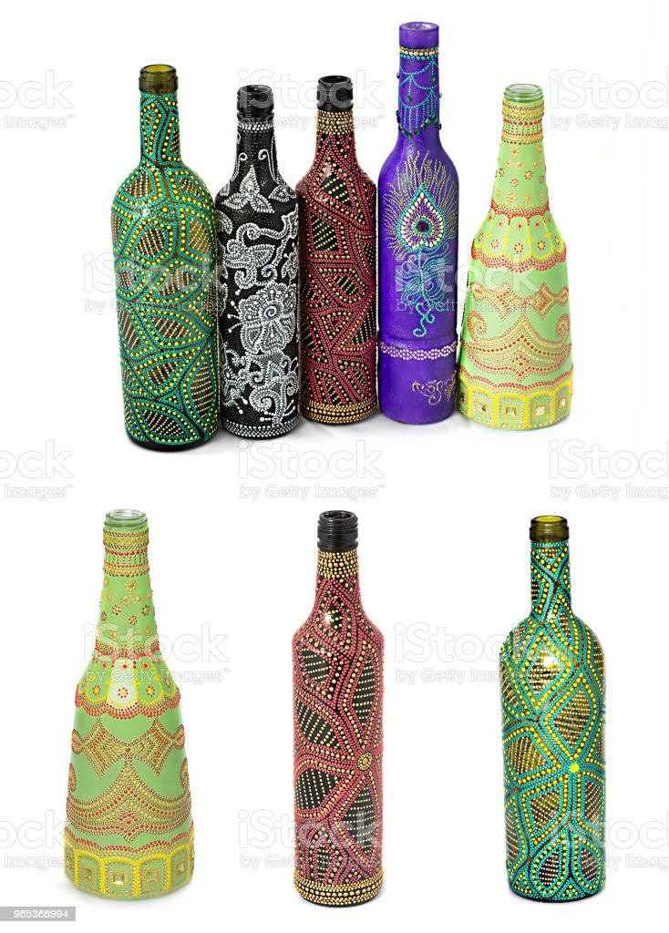 many different bottles, painted dot painted on isolated background. royalty-free stock photo
