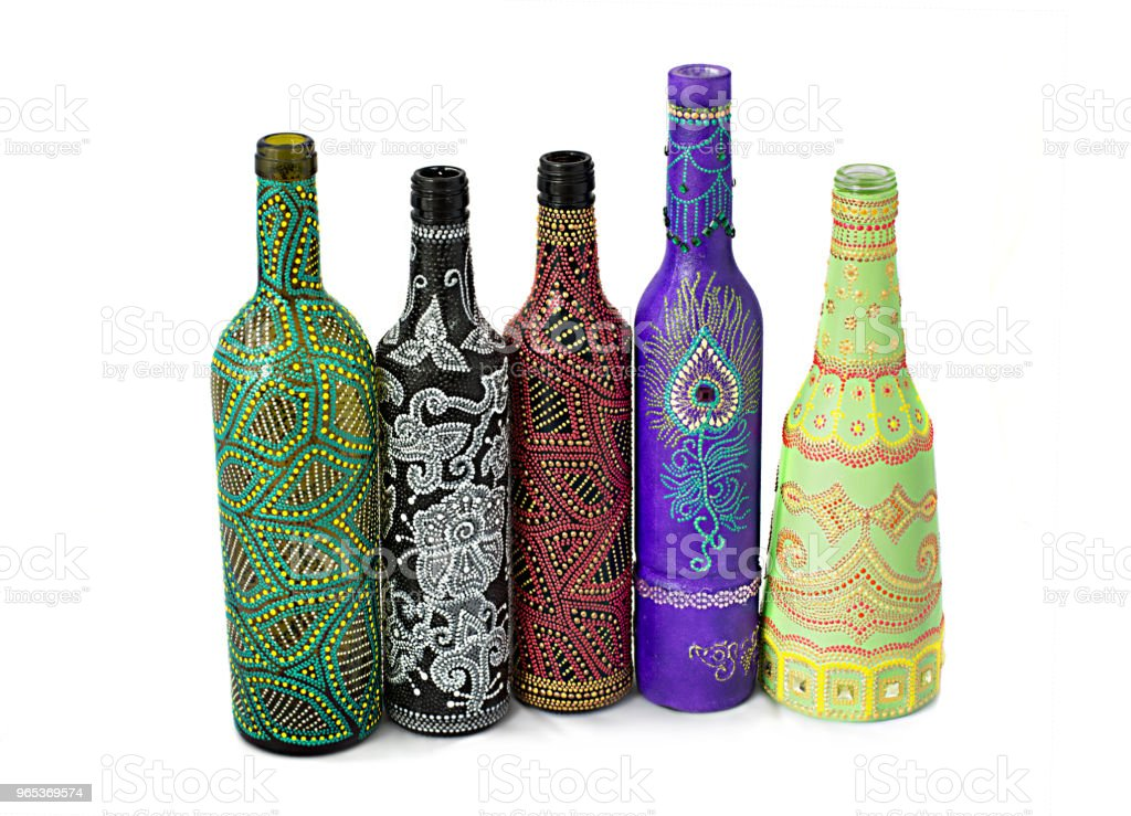 many different bottles, painted dot painted on isolated background. zbiór zdjęć royalty-free