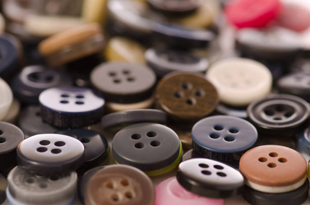 Many different buttons Many different buttons on a white background button sewing item stock pictures, royalty-free photos & images